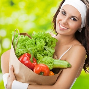Woman in fitness wear with vegetarian food